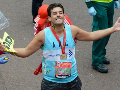 James Argent from TOWIE smiles and closes his eyes as he crosses the Virgin London Marathon finish line