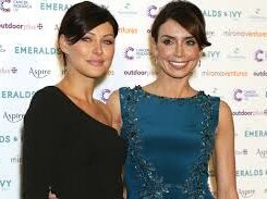 Emma Willis and Christine Bleakley pose for a photo on the red carpet as they arrive at the Emeralds and Ivy ball