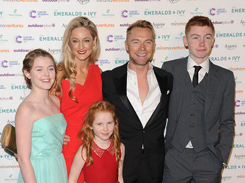 Ronan Keating and his family dressed in black tie pose for a photo as they arrive at the Emeralds and Ivy ball