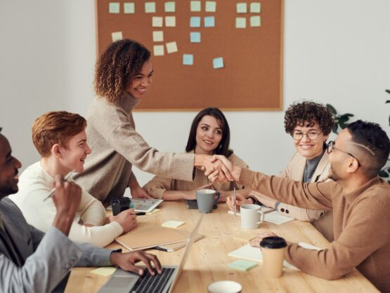 Group of people around a table in a meeting