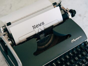 Typewriter with a piece of paper in there saying 'news' to illustrate the PR process