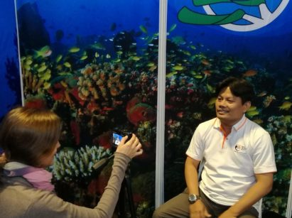 Photo of Green Fins assessor Marthen being filmed for Reef-World's communications channels