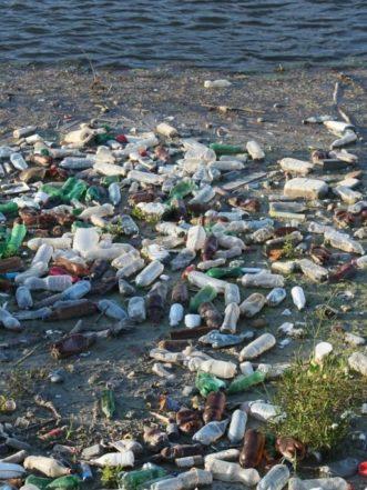Trash littered across a beach